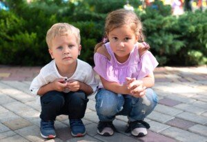Why Young Children Squat Easier than Adults