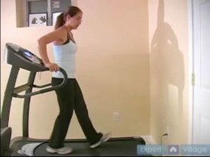 walking backwards on treadmill and holding on