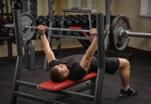 Locking Elbows Out During Bench Press: Pros & Cons