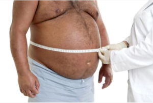 doctor measuring fat man's waist