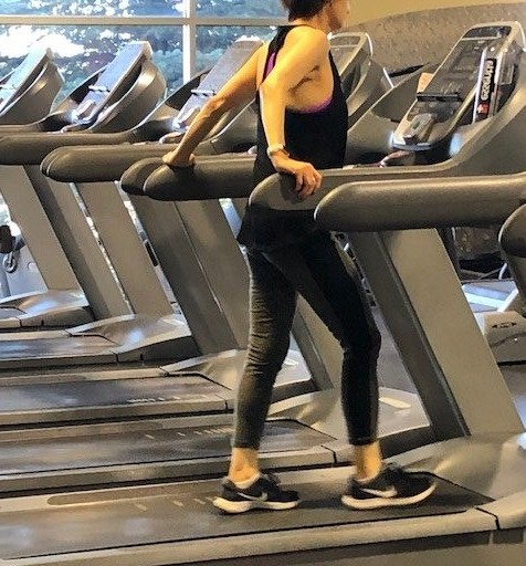 Why Holding a Treadmill's Side Rails Behind You Is Bad